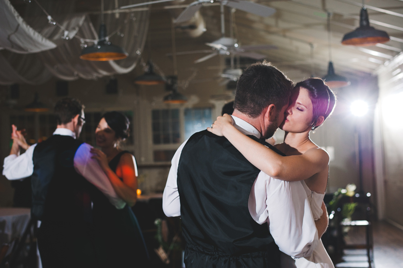 Newlyweds snuggle on dance floor // Elissa R Photography