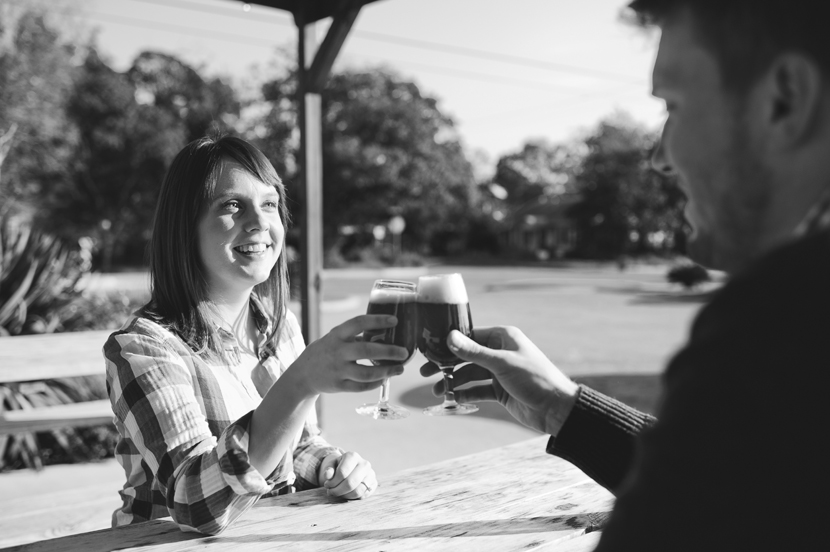 Couple cheersing with a Belgian beer // Elissa R Photography