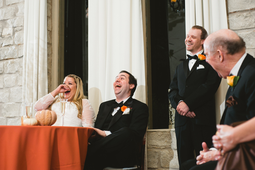 Laughing couple at wedding toast dinner // Elissa R Photography