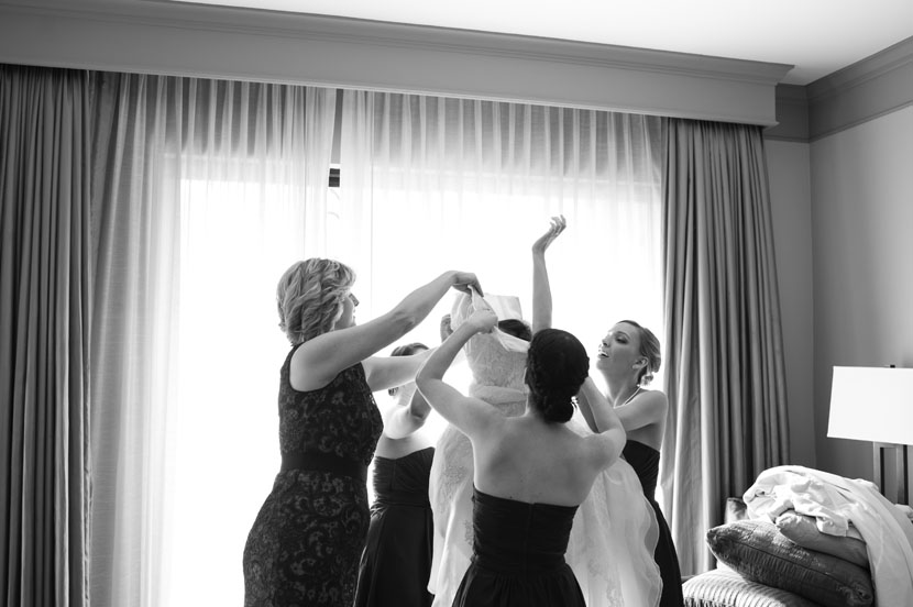 Beautiful bride getting dressed photo // Elissa R Photography