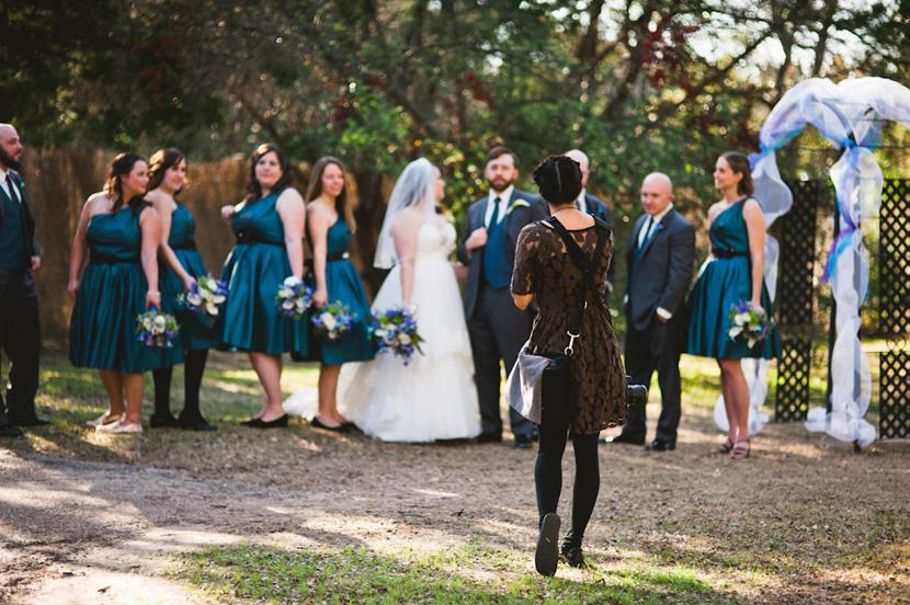 gesturing wedding photographer