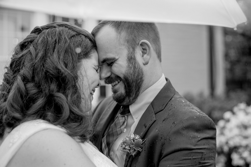 rainy wedding day bride groom portraits