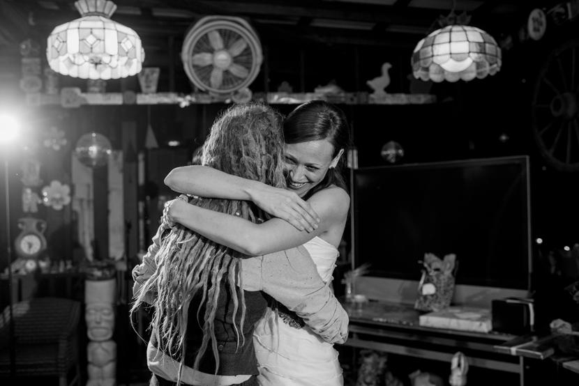 just married brides hug