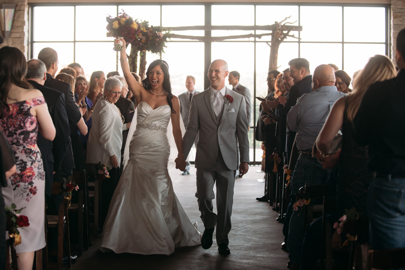 happy couples walking down the aisle