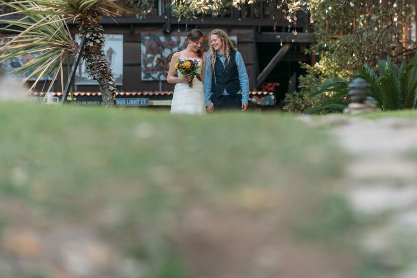 brides walk each other down the aisle