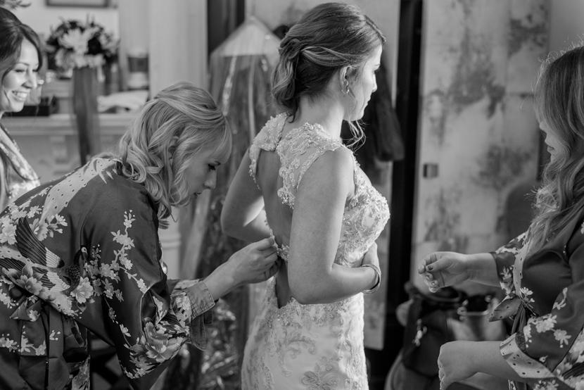 bride getting dressed at hotel ella