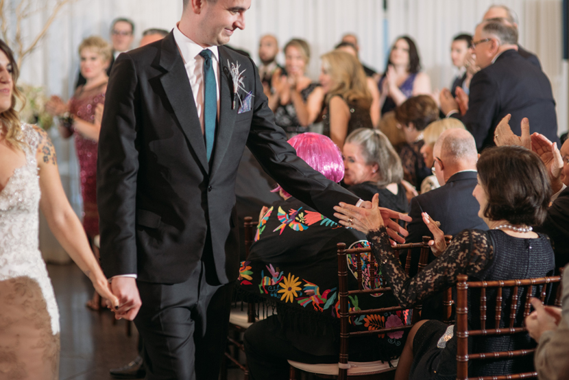 emotional groom during the recessional
