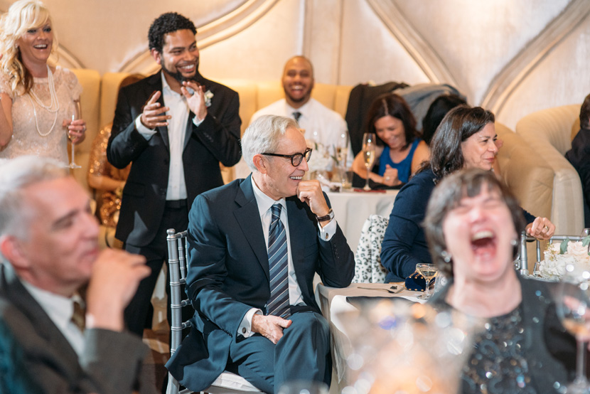 guests reacting to wedding toasts