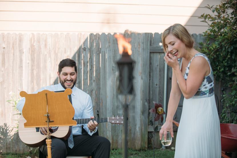 groom serenades his bride in homegrown wedding