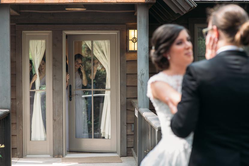bride groom first look with bridesmaids peeking