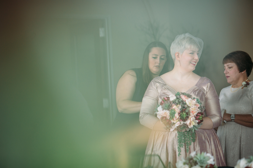 artistic photo of a bride before the ceremony