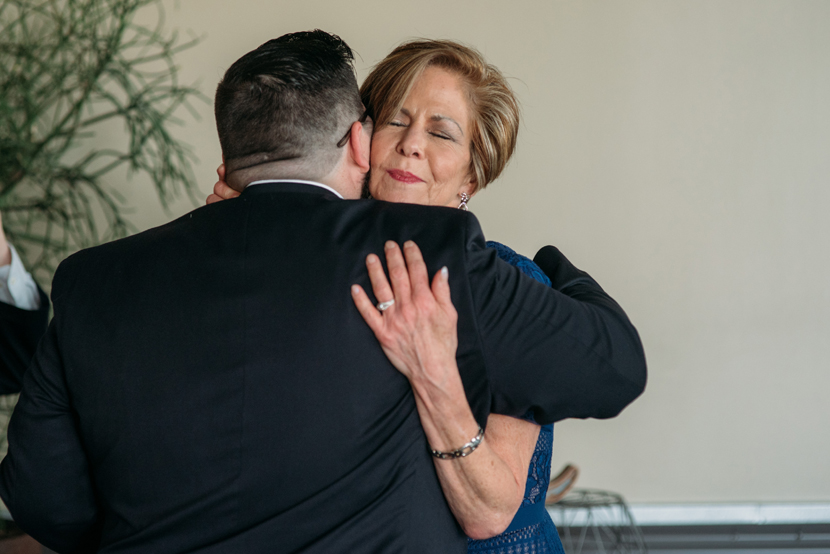 groom's mother hugs her son
