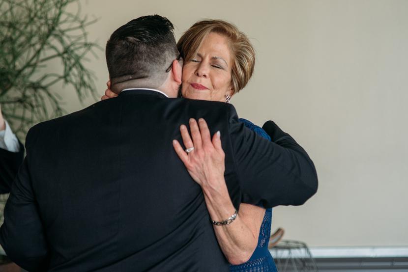 groom's mother hugs her son
