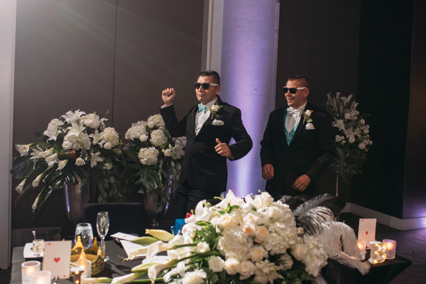 two grooms enter their wedding reception at w austin