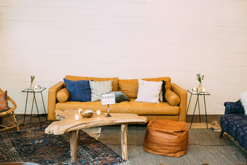 a lounge area styled with loot vintage rentals