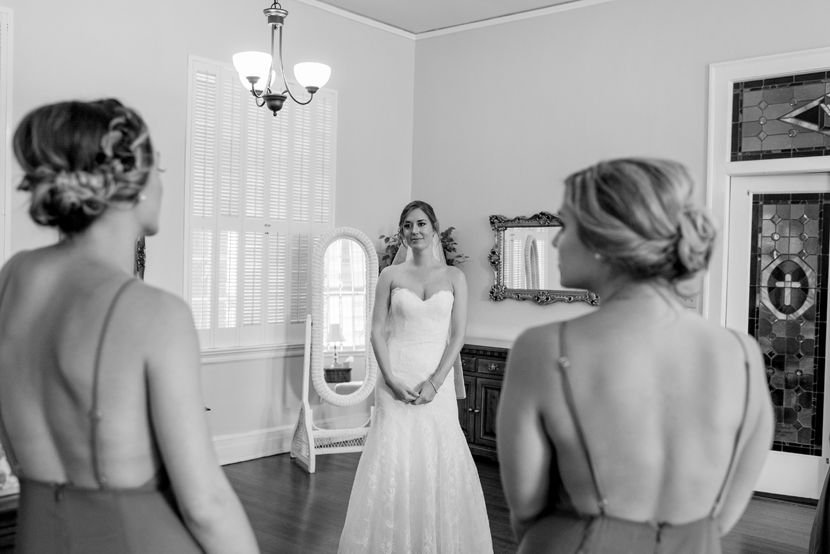 bridesmaids reacting to bride in gown
