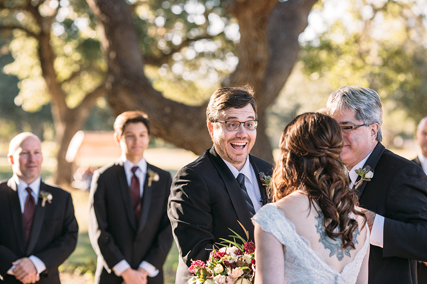 happy groom sees his bride at the altar