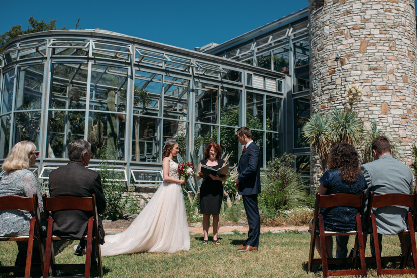 wedding ceremony in front of the greenhouse