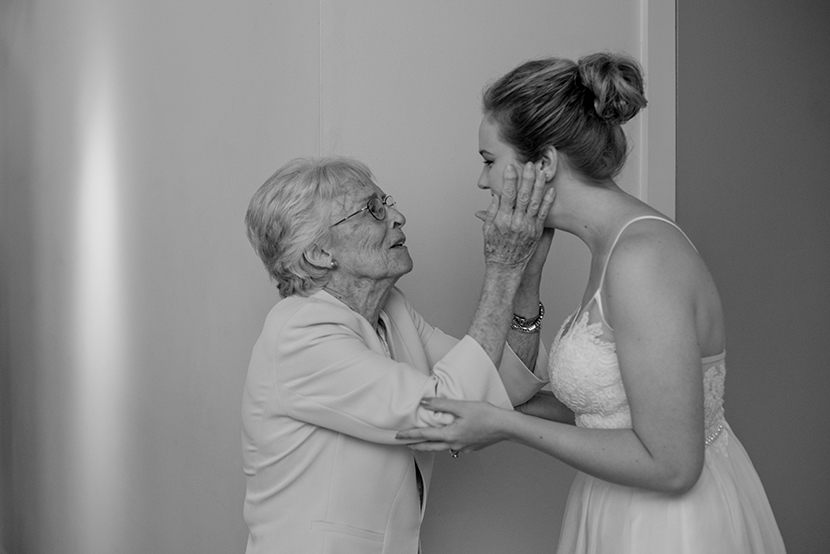 grandmother of the bride embraces her granddaughter