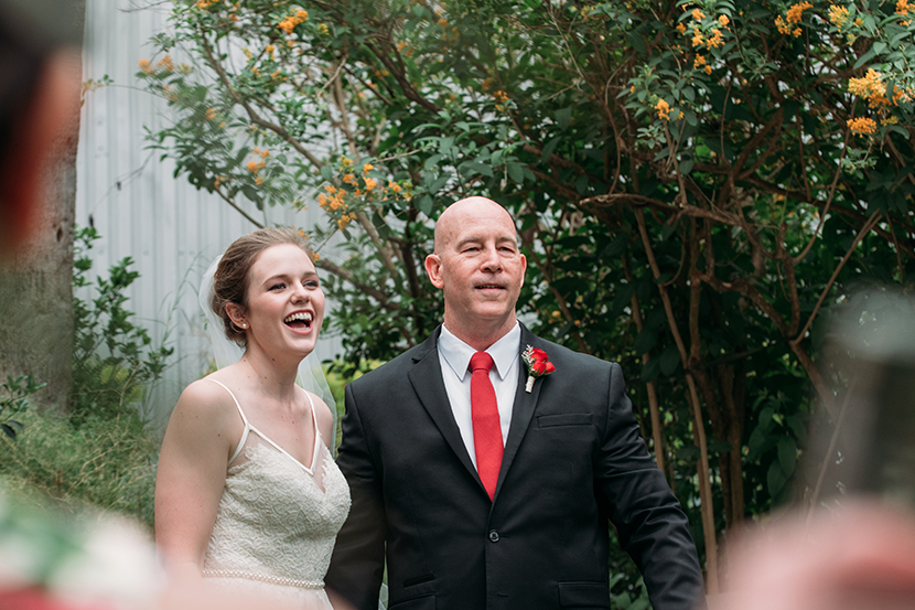 bride and father laugh on wedding day