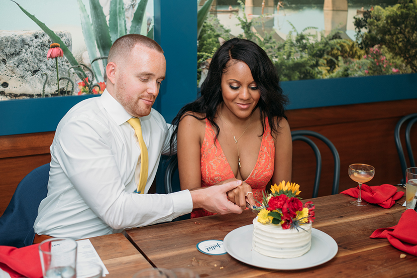 Couple cutting the cake at their small reception