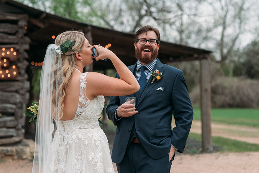 drinking a beer during your wedding first look