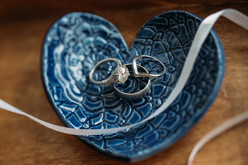 ceramic ring dish holds wedding bands