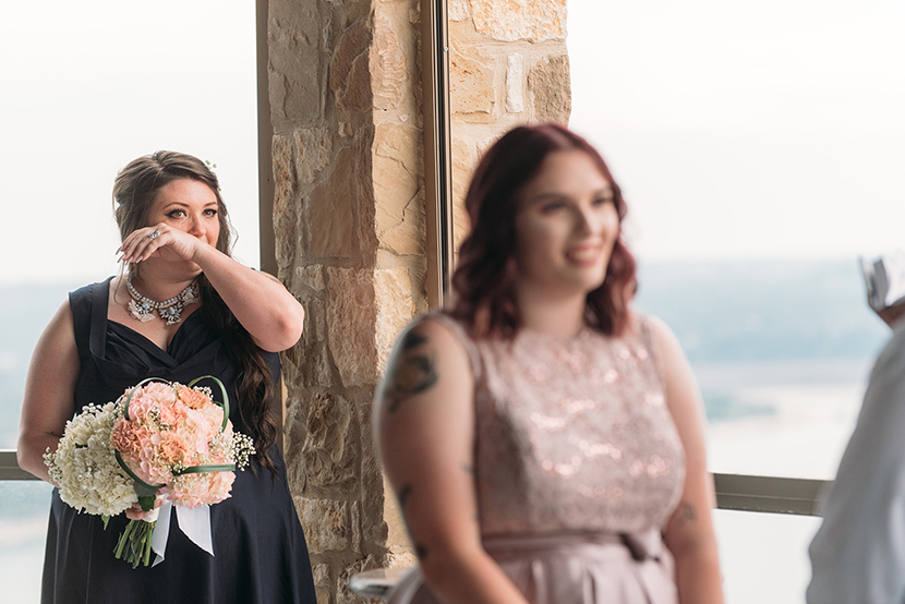 sister of the bride cries during ceremony