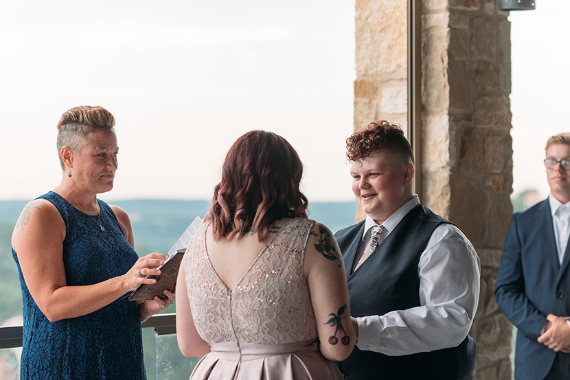 two brides exchange vows
