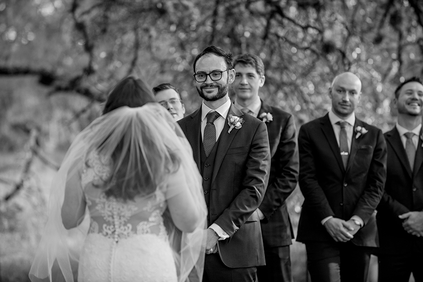 Groom reacts to bride reading her vows