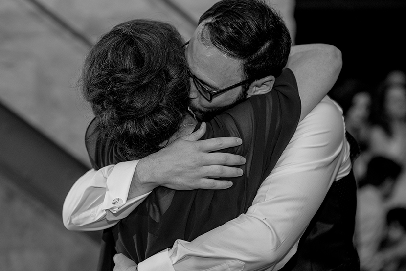Groom embraces mom after mother son dance