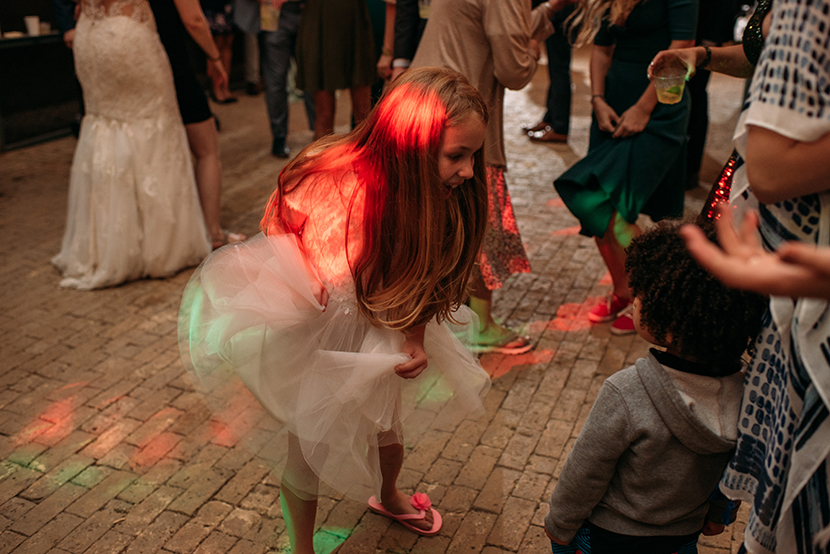 Tiny wedding guest dances during reception