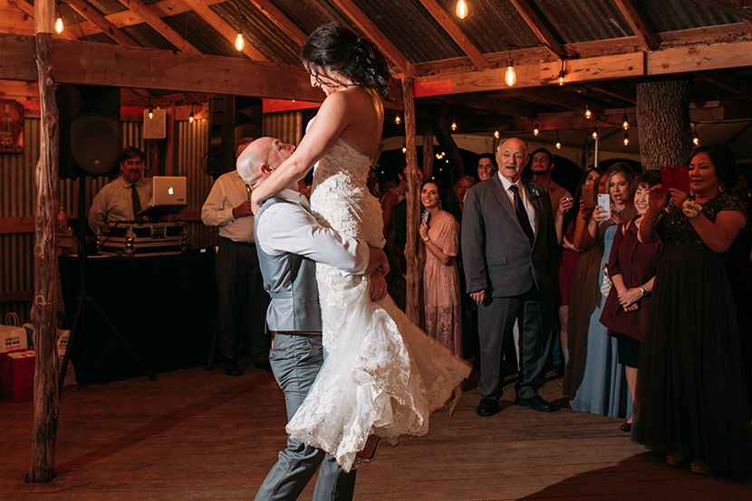 Groom lifts his bride during the first dance