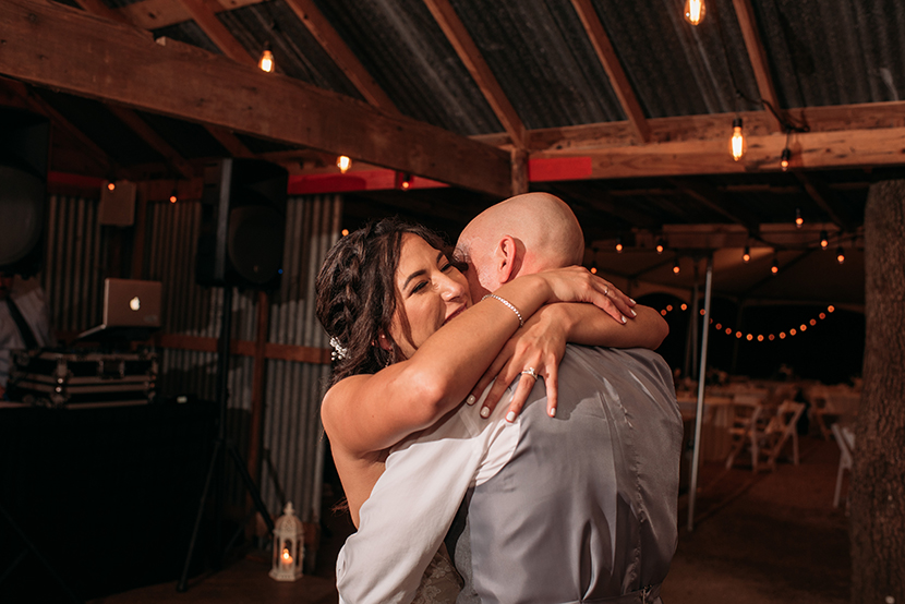 Bride hugs her new husband at the end of the final dance