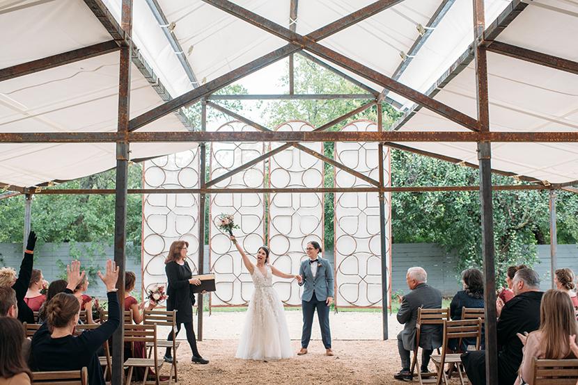 brides rejoice after their wedding ceremony