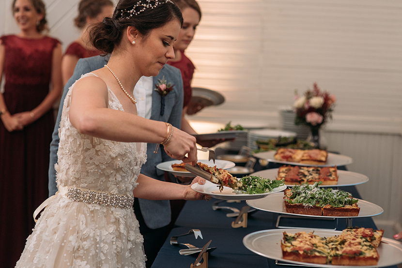serving gourmet pizza at your wedding reception
