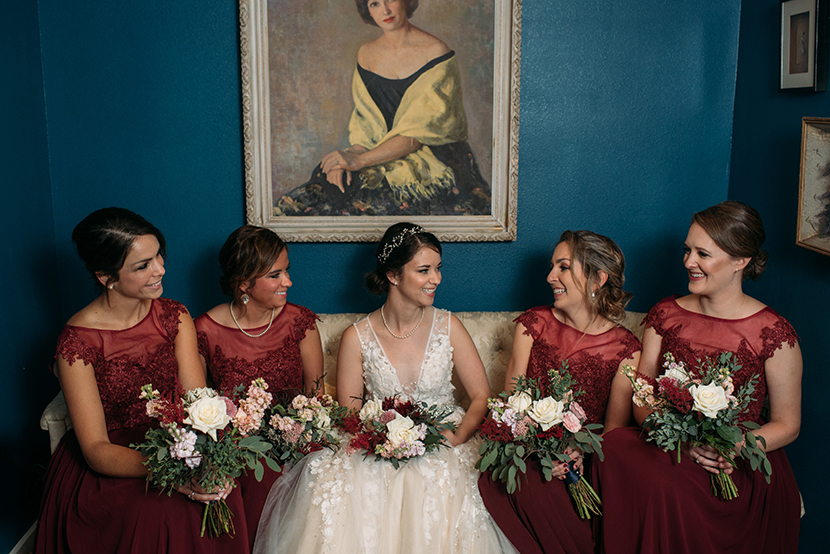 bride with bridesmaids at pearl snap hall blue room