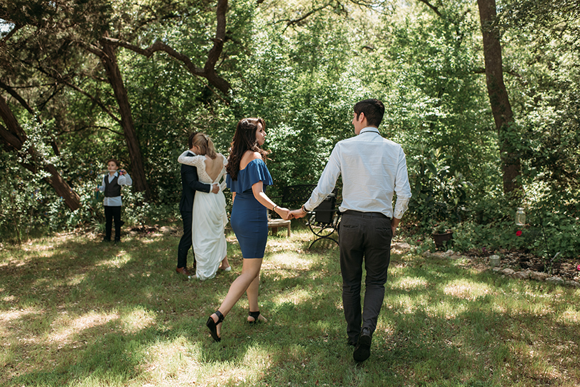 couples join the bride and groom on the forest dance floor