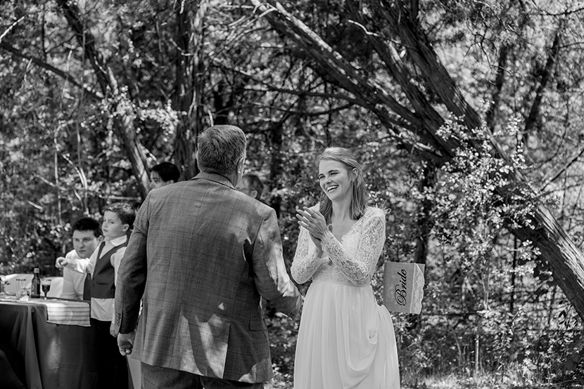 bride greets her father before the father daughter dance