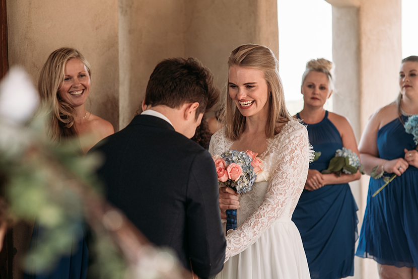 bride laughs at the altar