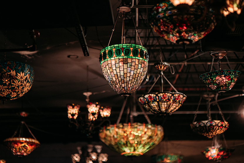 tiffany lamps hanging from nouveau art bar ceiling