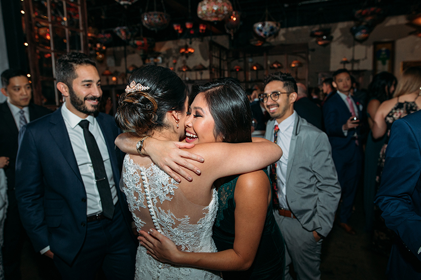 bride celebrates with her friends after the wedding