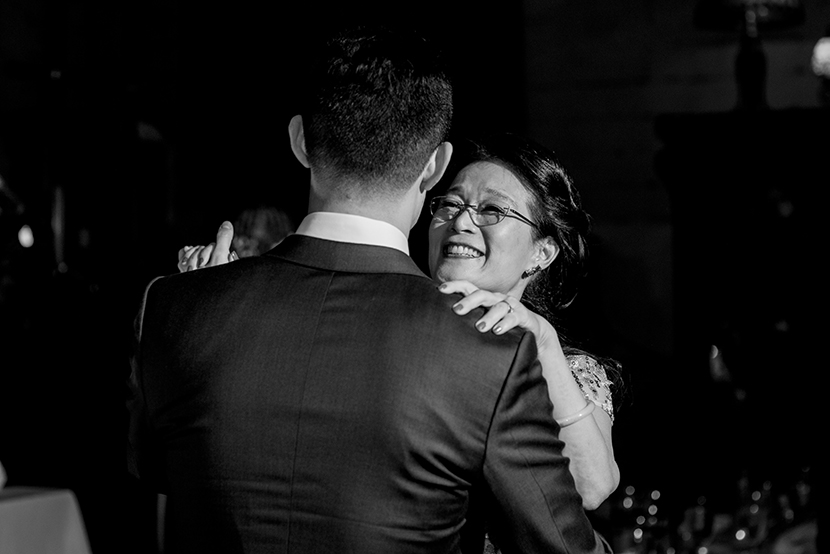 groom dances with his mother at his wedding