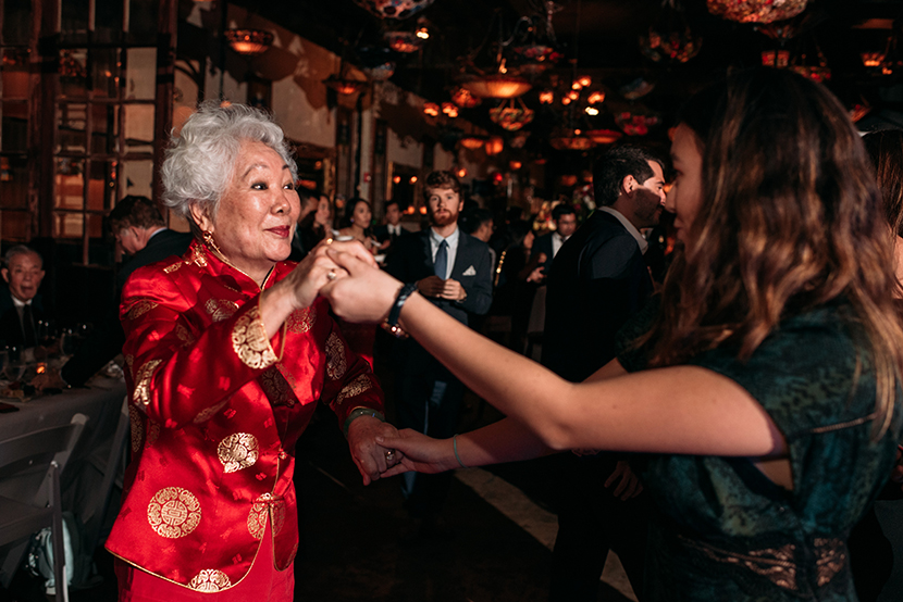 grandmother dances with friends at wedding
