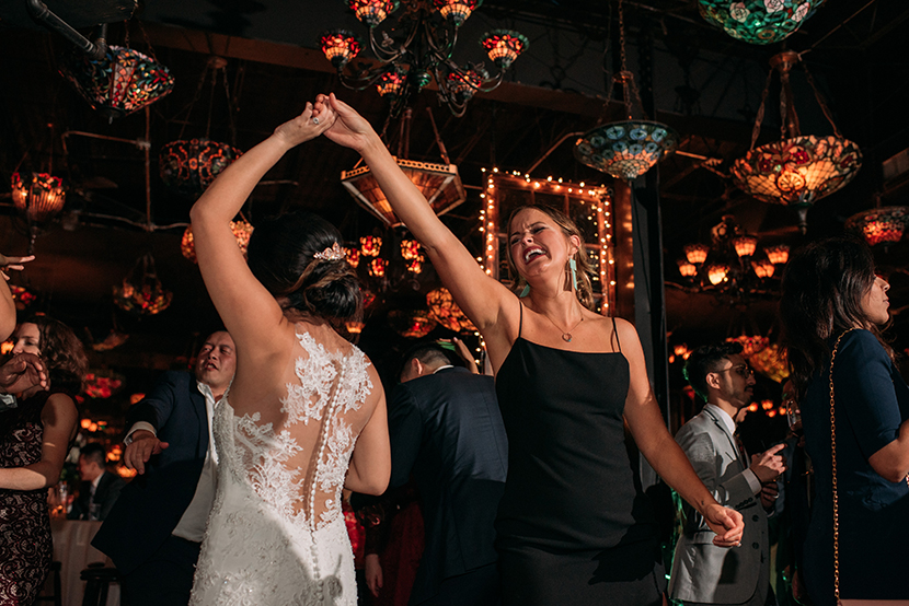 bride dances with her friends at her wedding reception